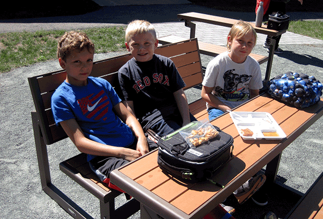 Students eating lunch outdoors