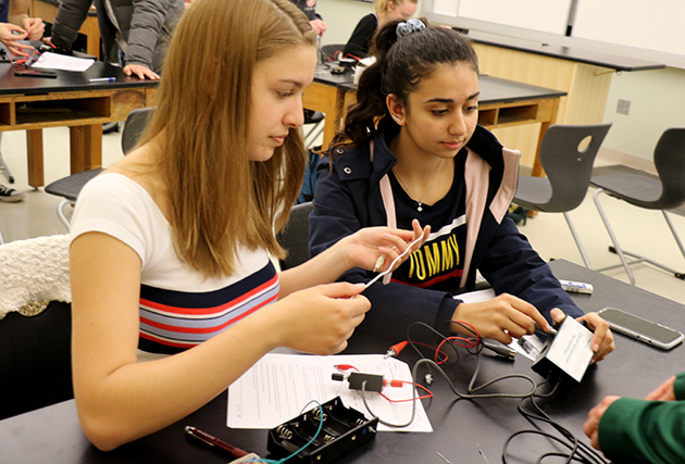 Students wiring circuits