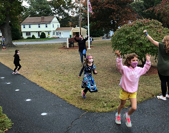 Second graders dancing in the rain